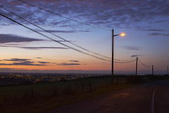 city limits... (CatMacBride) Tags: night road city lights street view sunset