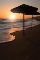 Sunset at Vrachos-Loutsa beach (massonth) Tags: caonon eos 60d beach ombrella wave sand sun reflection sea ionian black orange
