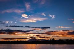 Lone Canoer on Lake Hiawatha (michaelraleigh) Tags: hiawatha sunset serene highquality minneapolis canon sun clouds sky shadows secluded f18 silhouette beautiful reflection infocus red 50mm outdoors green canoneos5dmarkii lake minnehaha minnesota