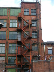 Bolton, Lancashire fire escape on derelict mill (rossendale2016) Tags: accrington red bricks drain pipes drainpipes high mesh iron rust rusted rot rotted rotting dangerous worn up seies rusty steps escape fire mill derelict lancashire bolton