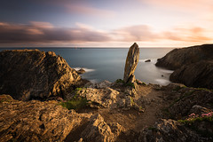 The Megalith II (Tony N.) Tags: france bretagne britanny finistre pointesaintmathieu megalithe megalith menhir dolmen sunset coucherdesoleil rocks rochers sky ciel nuages clouds poselongue longexposure tonyn tonynunkovics plougonvelin