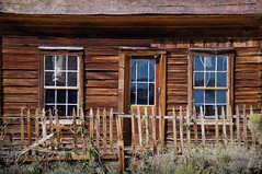 All She Wanted Was A Picket Fence (nedlugr) Tags: california ca door old windows usa reflections weeds porch ghosttown weathered bodie ruraldecay tinroof picketfence oncewashome