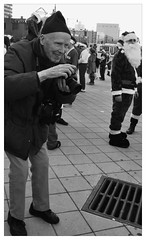 Bill Cunningham (Graceiee B) Tags: street people urban bw newyork blackwhite interesting candid citylife adorable streetphotography santacon streetshot iphone billcunningham placetovisit uploaded:by=flickrmobile flickriosapp:filter=panda pandafilter