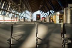 The Wait (José Garrido) Tags: madrid trip travel sunlight home architecture airport spain shadows seat terminal backhome terminal4 barajas josegarrido madridbarajasairport nikkorlenses communityofmadrid nikond800 nikkorafs50mmf18g