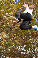 Over The Top (Smith-Bob) Tags: street autumn people man tree leaves fly athletic high dangerous jump candid melbourne dude southbank midair leap parkour vanhalen risky