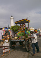 Men Pulling A Float Carrying The Statue Of A Hindu Deity During Masi Magam Festival, Pondicherry, India (Eric Lafforgue) Tags: street shirtless people lighthouse india flower colour wheel statue walking outside outdoors day god religion ceremony belief barefoot devotion offering motorcycle ritual procession seafront rickshaw devotees pulling groupofpeople tyres pondicherry offerings ratha menonly charriot urbanscene religiousfestival pondichéry indianculture flowergarland eventsinlife puducherry mixedagerange masimagamfestival unionterritoryofpondicherry bengalicharacter a0702440