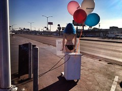 Barely Working (misterbigidea) Tags: street city blue light urban signs mannequin beauty sign standing balloons advertising landscape model holding downtown view mechanical pacific working scenic billboard human bikini wig poles avenue tiedup job stockton employee distraction minimum wage behindthescene waver humandirectionals signspinner signwaver nohiddenfee