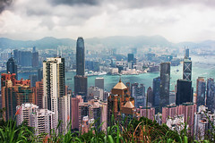 Hong Kong from Victoria Peak (` Toshio ') Tags: china city mountain water grass architecture clouds buildings hongkong harbor cityscape pollution thepeak kowloon victoriapeak victoriaharbor toshio mountaustin