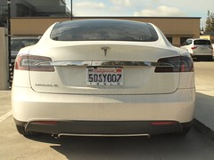 Tesla Sedan, from behind. (wbaiv) Tags: olympus ep2 fixed sensor quarterframe micro43 om1 24mm f28 85mm f20 manual focus wideopen cars automobiles vehicles taillights brake lights backup turn signals rear vehicle lamps bulbs covers redpart amber lens red car automobile motor transport land wheeled
