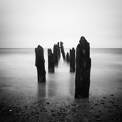 The end of it all (Moritz Braun) Tags: wood longexposure light shadow sky bw cloud white seascape black water monochrome canon germany dark square deutschland seaside meer mare fineart shift calm balticsea rotten simple groyne ostsee schwarz lumber langzeitbelichtung kühlungsborn mecklenburgvorpommern seebrücke buhne ostseebad seebad schwarzundweis canon5dmkii