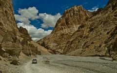 Dusty Road !! (Rishabh Shukla Fotography) Tags: leh roads mountain dust himalaya stones clouds