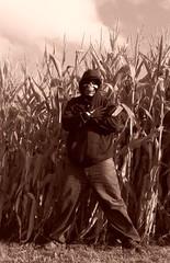 Dark Destiny Corn Guardian (PhotoJester40) Tags: cornfeilds outdoors outside sephia darkdestiny masked mysterious guardian militarystance male guy