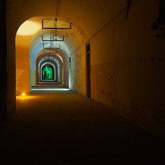 Green at the end of the tunnel (guenther_haas) Tags: wilhelmsburg ulm nacht nachtaufnahme licht light tunnel germany deutschland olympus omd em5 orange green grn end ende bundesfestung livetime painting colours gang mauern denkmal