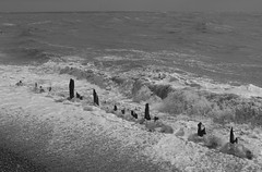 The Ravaging of the Waves (Henry Hemming) Tags: winchelsea beach waves groynes storm breakers mono bw black white foam spray stormforce destroy destuction erosion