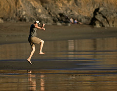 joie de vivre (me*voil) Tags: cafiles man beach joy action reflections waybackwhen muirbeach