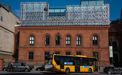 2016 - Baltic Cruise - Copenhagen - Danish Modern Meets Traditional (Ted's photos - For Me & You) Tags: 2016 balticcruise tedmcgrath tedsphotos copenhagen copenhagendenmark denmark bus yellowbus arches cropped vignetting bicycle streetscene street people peopleandpaths