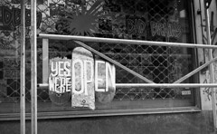 Yes we're open (Arne Kuilman) Tags: akarette xenon 50mm lens ilford xp2 nederland netherlands handheld c41 skateshop vijzelstraat skateboards independentoutlet schneiderkreuznach xenon50mmf2