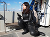 SpygirlMEG043B (mixnuts club) Tags: fetish gun bondage rubber spy wetsuits secretagent frogwoman