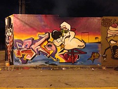 Ewok x Reds (missREDS_AM7) Tags: sunset graffiti character flamingo cartoon ewok graff reds 004 evolve am7 5mh fewandfar 004connec missreds