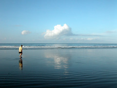 Curt walking on Jaco Beach, Costa Rica (Marlis1) Tags: clouds sand costarica pacific refelctions onexplore jac waterocean explored jacobeach marlis1 exploredec182012