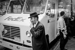 Holy Smokes (Roberto Novicini) Tags: nyc urban truck blackwhite manhattan streetphotography smoking contax hp5 rabbi fedex ilford contaxt3 diamonddistrict hasidim federalexpress chasidim hasid 47thstreet