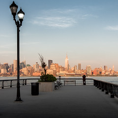 New York in sight (Michel Couprie) Tags: city nyc sunset usa newyork building skyline canon river eos pier solitude alone cityscape photographer streetlamp manhattan esb empirestatebuilding lonely hudson quai hoboken ville coucherdesoleil seul fleuve skyscrapper photographe gratteci