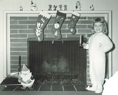 Ho Ho Ho!  Merry Christmas to you, flickr friends (sctatepdx) Tags: christmas fireplace snapshot santaclaus vernacular candleholder pajamas footiepajamas fireplacemantle christmasstocking oldsnapshot vintagesnapshot