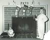 Ho Ho Ho!  Merry Christmas to you, flickr friends (sctatepdx) Tags: christmas fireplace snapshot santaclaus vernacular candleholder pajamas footiepajamas fireplacemantle christmasstocking oldsnapshot vintagesnapshot
