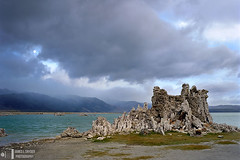 Full Moon and Tufa, Mono Lake (James L. Snyder) Tags: california park morning autumn sea usa moon lake seascape storm fall beach rock horizontal fog clouds sunrise early october rocks veiled cloudy spires foggy rocky atmosphere overcast stormy sierra fullmoon formation nationalforest craggy salty shore highdesert cumulus limestone jagged brooding rough monolake sierranevada desolate alkaline barren crags tufa saline blackmountain moonset pinnacles sculpted 2010 seastacks blackpoint otherworldly statuesque coarse easternsierra leevining inyonationalforest dunderbergpeak monocounty virga snr monobasinnationalforestscenicarea southtufa monumentridge outcroppings distantmountains monolaketufastatereserve statenaturalreserve monovalley kavanaughridge