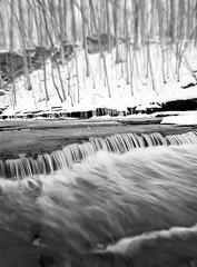 Winter Creek (Bernie Kasper) Tags: statepark travel winter bw white snow art nature water creek river landscape photography waterfall nikon hiking madison waterfalls d200 effect cascade kasper cliftyfalls naturephotography jeffersoncounty madisonindiana cliftyfallsstatepark berniekasper
