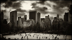 Ice Skaters in Central Park (Feldore) Tags: park christmas new york city ice skyline skyscrapers sony united skating panoramic skaters skate rink states mode sweep mchugh rx100 feldore