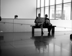 Read the Paper (Kevin VanEmburgh Photography) Tags: light blackandwhite reflection art bench reading nikon couple sitting kansascity missouri artcenter nelsonatkins nikond700 kvanemburgh