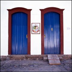 A.D. 1667 (*johnnyfavorite) Tags: door city travel blue brazil 120 6x6 film brasil paraty square town kodak parati slide hasselblad journey epson e100vs 500cm 1844 1667 v700 johnnyfavorite analod