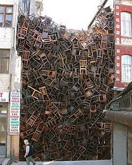 #ridiculous amount of #chairs piled up between 2 #buildings lol. #absurd and #unbelievable lol  (Pretty Cool Pic) Tags: pretty cool ridiculous amount chairs piled up between 2 buildings lol absurd unbelievable