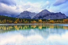 Wedge Pond clouds and leaves (John Andersen (JPAndersen images)) Tags: alberta clouds fall fullmoon harvestmoon kananaskis landscape leaves morning mountains orange purple reflections river sky trees yellow