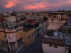 Santiago de Cuba at dusk. (PebblePicJay) Tags: santiagodecuba dusk redsky latinamerica cuba cubana rooftop