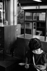 At the furniture store (otonasoto) Tags: sony a7rii loxia250 zeiss furniture littlegirl girl monochrome