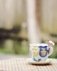 Soft (hellobright) Tags: teacup tea cup fresh flower outdoor beautiful butterfly green glass drink beverage dof depthoffield porcelain