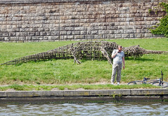 Crocodile ate tourist (Antropoturista) Tags: poland krakau krakow crocodile bike man smartphone street people fun divertido