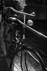 Bike at canal in Amsterdam 27 (Amselchen) Tags: bicycle mono bw light bokeh dof depthoffield fuji fujinon fujifilm xe1 xf35mmf14r amsterdam city canal water