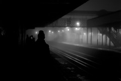 Power cut on platform 4 (Dan Chippendale) Tags: winter blackandwhite bw woman white mist black london station blackwhite waiting noir moody noiretblanc trainstation rails powercut filmnoir grovepark bromley leicadigital december2012 leicam9 leicasummilux50mmasph