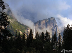 Daybreak, Yosemite Falls (James L. Snyder) Tags: california park morning autumn trees usa painterly mountains tower fall yosemitefalls water rock horizontal fog wall clouds forest early waterfall nationalpark woods october moody veiled cloudy foggy dramatic atmosphere falls cliffs sierra glorious evergreen pines valley yosemite granite mysterious brooding yosemitenationalpark fading soaring obscured delicate dreamlike sierranevada fleeting majestic vanishing monolith chiaroscuro vignette 2009 ephemeral looming shrouded enchanted daybreak clearing towering yosemitevalley evanescent lofty clinging spectacle lingering grandeur retreating mariposacounty vaporous yosemitepoint upperyosemitefall eagletower lostarrow