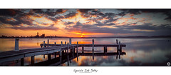 Squids Ink - Jetty (John_Armytage) Tags: sunset panorama sun reflection clouds newcastle photo colours dusk pano jetty australia panoramic nsw canon5d carlzeiss novaflex squidsink johnarmytage wwwjohnarmytagephotographycom carlzeiss50ml14