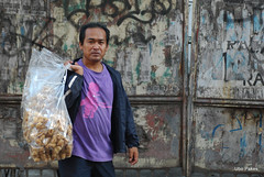 Chicharon (ubo_pakes) Tags: street door old city people urban food man rind photo nikon rust gate asia grafitti outdoor decay grunge philippines plastic pork snack cebu vendor salesman visayas hawker delicacy chicharon d60 chicharron porkrind ubo pakes knabbelspek