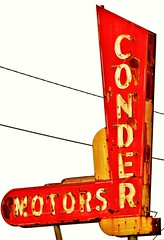 Conder (tikitonite) Tags: auto street urban sign metal vintage dead rust automobile neon decay ghost rusty motors signage roadside crusty carlot alloy fragment advertise usedcars oxidized redrust conder ghostneon yellowrust