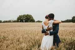 Hugs (M. Klasan) Tags: wedding field gold wheat hug bride groom portrait warm ring wide angle outdoor nature landscape country land austria white dress blue suit flowers backless