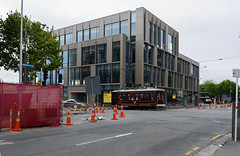 All Aboard (Jocey K) Tags: newzealand christchurch architecture building cbd rebuild construction road street roadcones trees sky clouds tram