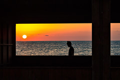 Behind the window [explore] (Caterina Zito) Tags: sunset sea silhouette beach sky atardecer