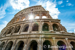 Rome, Italy- View of the famous stone amphitheater known as the Roman Colosseum located east of the Roman Forum. Officially known as the Flavian Amphitheater, it was commissioned by Emperor Vespasian as a gift to the Roman people. Gladiatorial combats and (Remsberg Photos) Tags: europe italy rome ancient ancientcivilization roman architecture buitstructure tourist sightseeing photography history historical internationallandmark capitolcity romaprovince ancientrome art flavianamphitheater amphitheater gladiator animals animalfights combat entertainment romanpeople emperorvespasian bluesky ita