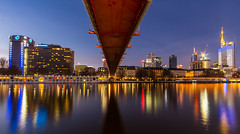 Frankfurt - Holbeinsteg (cfaobam) Tags: bridge blue light orange reflection water yellow skyline architecture night skyscraper canon reflections river germany deutschland lights evening am europe long exposure european cityscape hessen slow frankfurt main tripod central bank hour highrise banks commerzbank ecb deutsche hesse langzeitbelichtung mainhattan ezb blauestunde eos650 zentralbank deutschherrnufer europische bankfurt deutschherrnviertel cfaobam